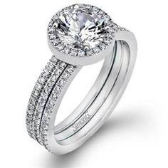 This beautiful Simon G halo engagement ring features round brilliant cut diamonds along the band. Simon G GR111 #arthursjewelers