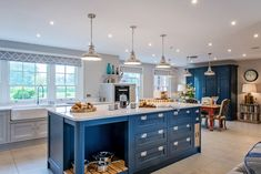 This shaker style kitchen has incorporated a bright navy colour into its cabinetry design for a bold edge Mr Mrs, Shaker Style Kitchens, Country Kitchens, Oak Chopping Board, Large Open Plan Kitchens, Larder Unit, Soft Seating, Traditional Kitchen, Entertainment Center