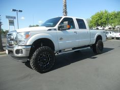 Perfect!  Not raised TOO high, but still customized a bit. This is a new 2012 Ford F-250 Diesel for sale by Corning Ford.