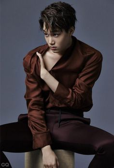EXO's Kai transformed into a flower boy for a 'GQ' pictorial.The handsome idol casually rests a larg…