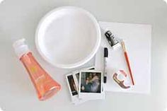A Polaroid camera and film OR  A 3″x3″ glossy photo print  Black acrylic paint  Dish soap  Scotch tape  Paper plate (or surface for mixing paint)  Piece of paper  Paint brush  Black marker