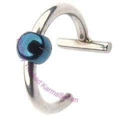 Surgical steel fake nose ring with a blue coloured ball. Fake Nose Rings gently clip onto the nostril to give the effect of a Nose Piercing.