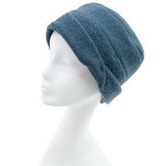 Nina -- Comfy boiled wool cap with subtle segments and twisted brim detail.