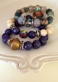 Sapphire faceted Agate beaded stretch by CountryChicCharms on Etsy, $42.00. Each bracelet sold separately.