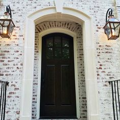 One of our favorites - Romabio Classico Limewash in Avorio White. Just enough brick is showing so the home looks like it's been in the family for generations. Such a beautiful entry! Product now available in select stores, and on their website. Exterior Paint Colors, Exterior Design, White Wash Brick, White Washed Brick Exterior, Exterior Makeover, House Painting, Painting Brick, Home Look, House Colors