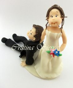 #Wedding Cake topper.  This is an example of a custom made Wedding Cake topper  Created by Cristina Sierras, #Bride dragging the Groom. I can customize the dress and tux just... #wedding #bride #groom #marroriage
