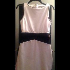Jennifer Lopez dress Block color dress. White,black, neutral with silver around the straps. Never worn. Willing to negotiate price. Jennifer Lopez Dresses