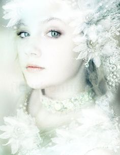 A very natural-looking snow queen with stunning grey eyes--contacts could be used to create that effect. No faux lashes, just simple white makeup. Elaborate headpiece, necklace, and dress make this almost more bridal than snow queen.