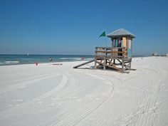Clearwater | Above: Clearwater beach has pure white quartz sand. Lifeguards watch ...