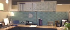 Fabric pinned to cubicle walls (Kumari Garden Tarika Blue) and cubby above desk adds personality to an otherwise-drab work station!