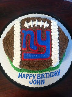 NY Giants cake {{I have never worked w/ fondant... and I don't think I have enough time to learn it before Is's bday party... But, I could do someting like this!!}}