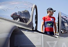 """ The current race leader of la Vuelta, Spain's Alejandro Valverde, poses with a AV-8B Harrier II aircraft on the Principe de Asturias aircraft carrier in Cadiz, Spain. Photograph: Miguel Angel..."