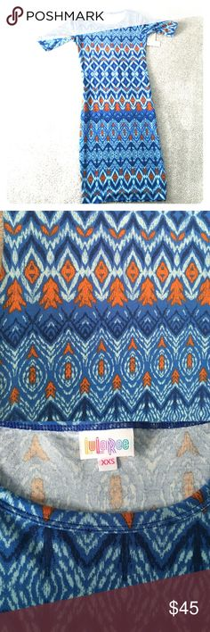 """NEW WITH TAGS!!! LuLaRoe Julia dress This is a new LuLaRoe dress with tags, in the style """"Julia""""! It has never been worn or tried on before. The dress features shades of blue and turquoise, complemented by orange arrows and triangular designs. It is in size XXS of LuLaRoe, with stretchy and soft material that this brand is known for! Love the buttery material! LuLaRoe Dresses Midi"""