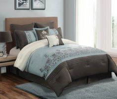 """8 Piece King Regency Slate and Taupe Embroidered Comforter Set by KingLinen. $99.99. Serene slate blue and taupe set accented with scroll embroidery will be a great addition to your bedroom. 2 decorative pillows and bonus euro shams included. FeaturesColor: Slate blue/Taupe/IvorySize: KingMachine washable Matching curtains availableThis set includes:1 Comforter (104""""x90"""")2 Shams (20""""x36""""+3"""")1 Bedskirt (78""""x80""""+15"""")2 Euro Shams(26""""x26"""")1 Square Cushions(17""""x17"""")1 ..."""