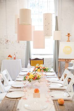 A Summer Wedding Shower // custom lanterns of various sizes from Fenchel Shades // covered each one with patterned paper.