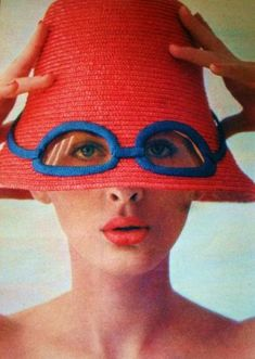 Model wearing a straw hat with built in tinted glasses 1965.