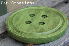 Thrifted cheese board, drill holes, paint = sewing room dec.  These would be cute in a group.