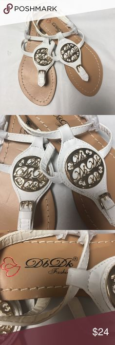 White cross cross back flat sandals Adorable sandals with metal medallion T strap design adjustable straps. Choose your option from the choices listed. I only have the options shown and will NOT restock.  See My closet for other colors DBDK Shoes Sandals
