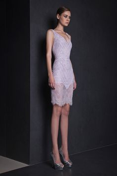 Short Lilac cocktail dress in Chantilly Lace with V neckline, featuring symmetrical band patterns.