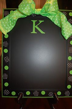 Chalkboard paint on a cookie pan .... you can also put magnets on it.