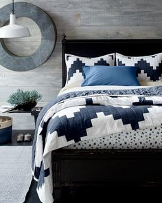 Gray wall panelling and art.  Chevron Quilt and Sham - Garnet Hill