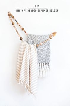DIY Minimal Beaded Blanket Holder by top Houston lifestyle blogger Ashley Rose of Sugar and Cloth #towelrack #bathroom #blanketholder #easyhomedecor