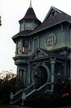 Victorian house with round entrance to porch