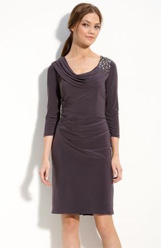 "Wearing this (in the non-petite version which I now can't find) for a January wedding. Warm and actually comfortable. Actual color is more purple than ""gunmetal"""