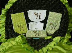 Baby shower gift set: personalized blanket made with flannel line satin in kiwi green and dark chocolate brown minky. Two personalized burp clothes, a custom travel baby wipe case, bib and a onsie. $85.
