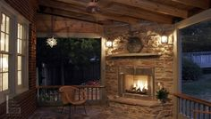 Rustic fireplace in screened porch with tile floor.  Photo courtesy of The Porch Company in Nashville.