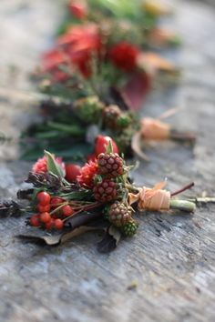 Seasonal, textural pin-on corsages in deep marsala and burgundy tones.