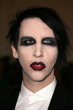 "It's rare when your husband wears more makeup than you, but in 2006, Marilyn Manson out-dolled his then-wife, Dita Von Teese. His signature full face of face paint worked well with the year's irreverent theme: ""AngloMania: Tradition and Transgression in British Fashion."""