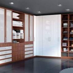 Vestidores y Closets: Vestíbulos, pasillos y escaleras de estilo translation missing: mx.style.vestíbulos-pasillos-y-escaleras.clasico por Interioriza