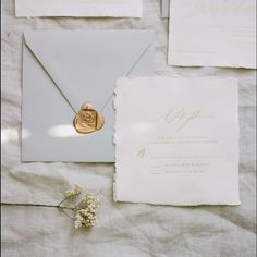 Gray and Ivory handmade paper invitations // gold foil invitations // square wax seal // rose wax seal // calligraphy and illustration and design by Written Word Calligraphy