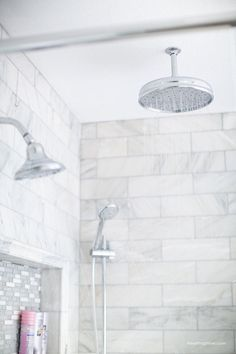 My shower- Carrara marble herringbone tile tile, white vintage tub and blue accents.