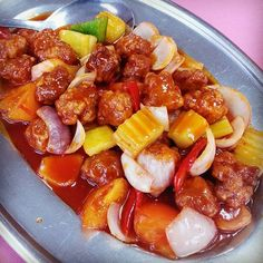 Sweet and Sour Pork, a popular chinese cuisine around the world #sweetandsourpork #chinesecuisine #sweetandsour #pork #chineserestaurant #chinesefood #chinesecooking #tomatoes #carrot #capsicum #cucumber #onion #eatingout #diningout #fromthetable #foodpics #foodie #foodphoto #foodphotography #foodlover #fooddiary #foodpost #instadaily #instagood #instaphoto #goodeats #sogood #photooftheday #tastyfood #deliciousfood  Yummery - best recipes. Follow Us! #tastyfood