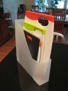 Use a magazine holder to store cutting boards
