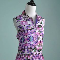 HOST PICK❤️L'Amour by Nanette Lepore Dress This sleeveless floral polo dress is really cute for a spring day. Only worn once. Large but runs small. Reasonable Offers Welcome. Trades. PayPal. Follow me on Instagram at @PRGirlCamille Nanette Lepore Dresses Mini