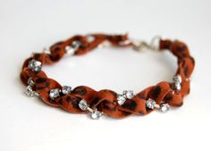 (studs and pearls): diy: Leopard Print Suede & Rhinestone Bracelet www.bergerbeads.net
