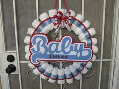 What a cute baby shower diaper wreath! See more party ideas at CatchMyParty.com.