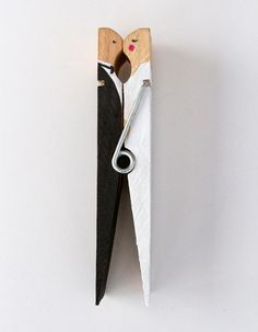 DIY Clothespin Couple. Would be cute to put a magnet on the groom and have the wedding date on the bride (which I'd add a veil to). Or have the clothespin hold a piece of paper up having all the information needed for the wedding on it.