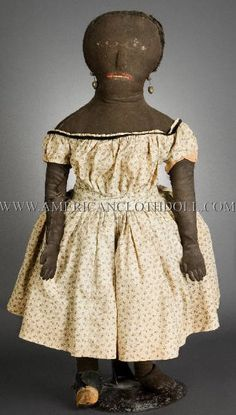 """Black Americana Doll: This large 30"""" stitched face has articulated fingers and toes, and although she has experienced some loss to the facial stitches, maintains remarkable presence and charm. This type of doll, made circa 1850 is extremely rare. She was found in New Hampshire about 15 years ago and is all original."""