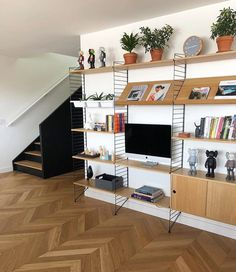 String Shelfie nicely styled by our friends @rndsqr_ ⚫️⬛️. The Swedish String Shelving is highly customizable. Contact us to learn about…