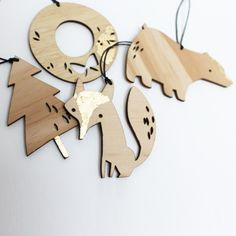 set of 4 christmas ornaments laser cut in 3mm plywood, with small detailing in gold leaf.