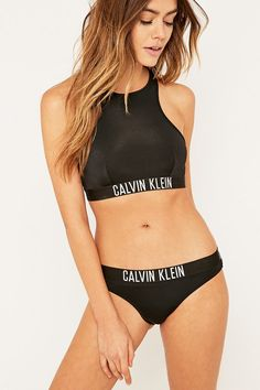 Shop Calvin Klein Black Bralette Bikini Top at Urban Outfitters today. We carry all the latest styles, colours and brands for you to choose from right here. Calvin Klein Femmes, Calvin Klein Women, Calvin Klein Black, Sexy Bikini, Bikini Sets, Bikini Top, Bikini Swimsuit, High Neck Bikini, Bikini Beach