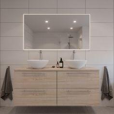 En lys, varm og tidløs stil med naturmaterialer og lyse fliser gir ditt baderom et lyst, varmt og nordisk uttrykk. Den runde vasken myker opp stilen sammen med de organiske formene på badekaret. Her får man et baderom som bidrar til en god og harmonisk start på dagen.