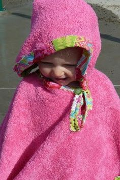 make a toddler beach towel poncho - I think with bigger towels I could make it for the big kids too.