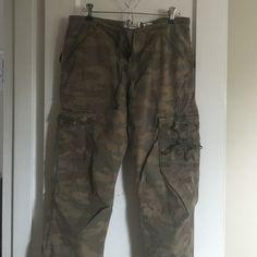 Camouflage cargos Lightweight stretch feminine cargo pants with a snap plus drawstring waist. Runs full Old Navy Pants Straight Leg