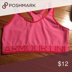 Under Armour sports bra Pink under armour sports bra. Not padded. In excellent condition. Under Armour Intimates & Sleepwear Bras