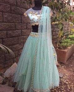 Stunning ice blue color layered lehenga and crop top with net dupatta. Crop top with flying bird and floret lata design hand embroidery gold thread work. Lehenga Crop Top, Red Lehenga, Lehenga Blouse, Lehenga Choli, Sarees, Crop Top Designs, Blouse Designs, Indian Dresses, Indian Outfits
